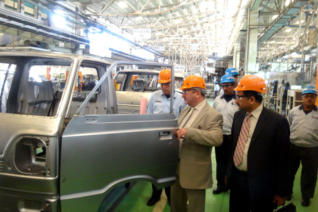 Pak Suzuki officials proudly inspecting cars from the 70s