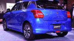 2017 Suzuki Swift blue rear three quarters left side launch event