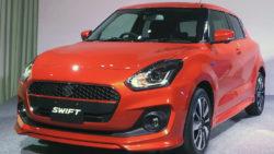 2017 Suzuki Swift red front three quarters left side launch event