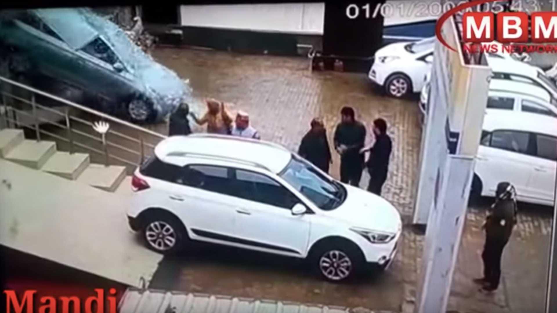 Women Crashes Hyundai Out of the Dealership Window 8