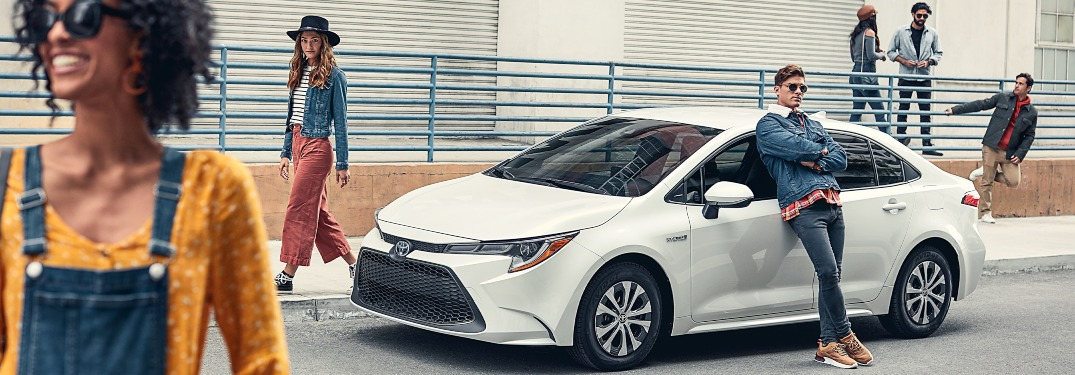 2020 Toyota Corolla white side view being guarded by hipsters o